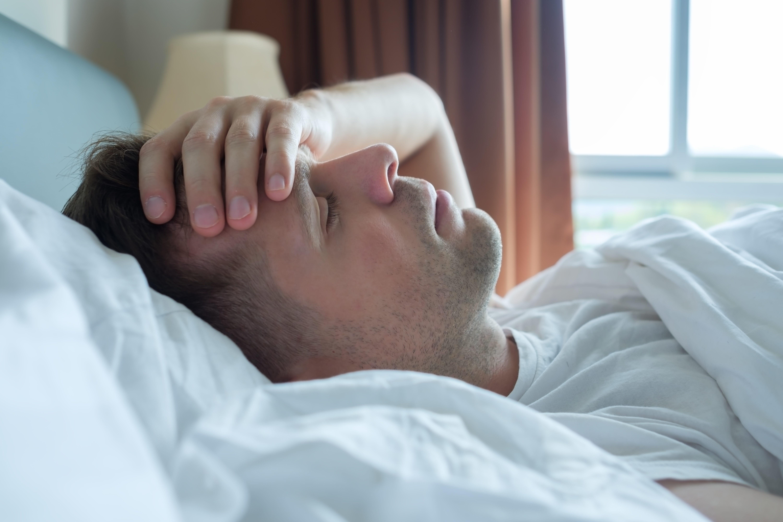 Man wakes up due to sleep apnea headaches