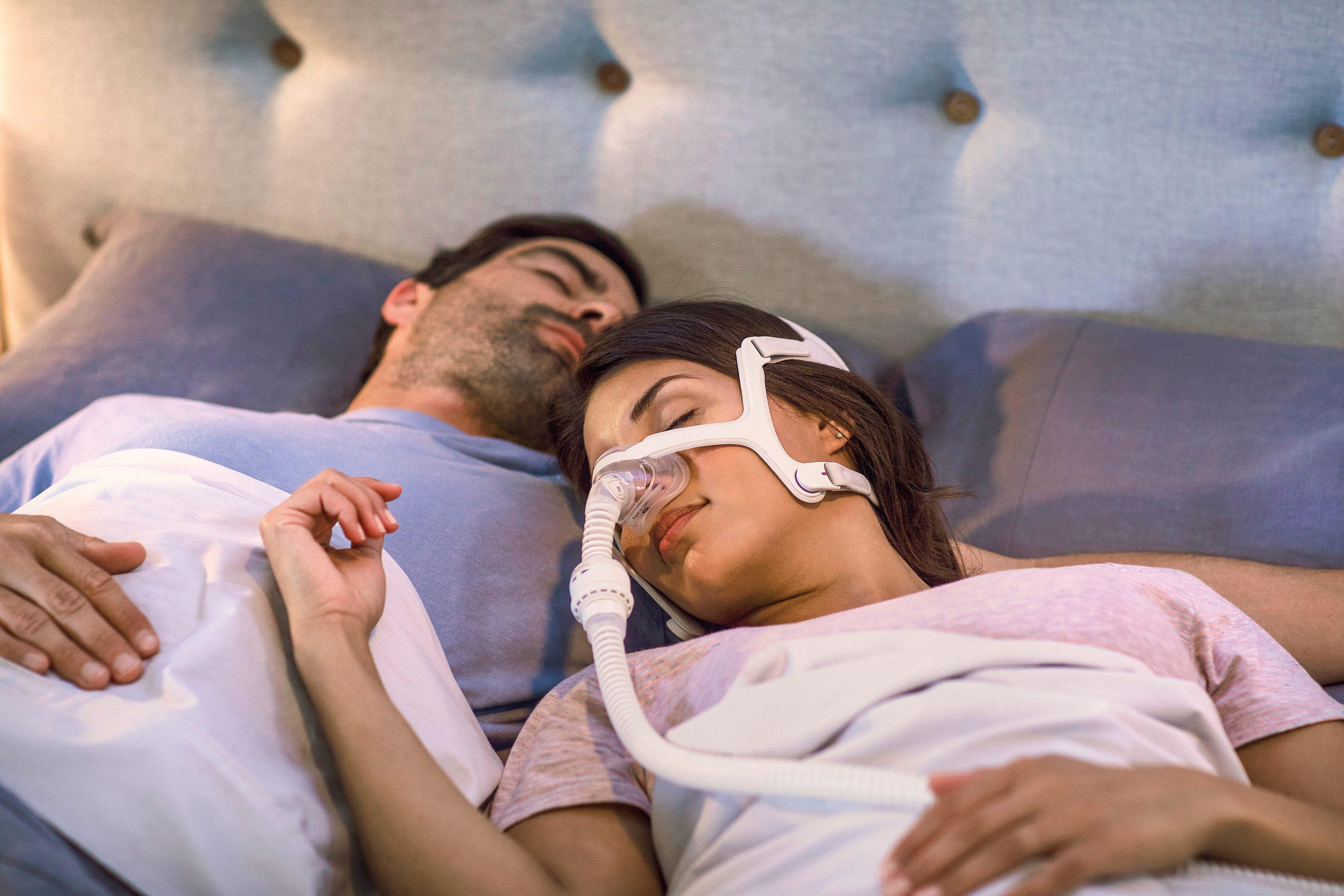 woman stops sleep apnea headaches with a CPAP