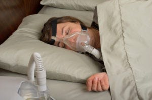 Woman with high CPAP pressure uses full facemask
